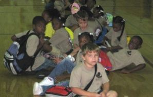 A Group of Kids on Mack Benn Jr. Recreation Center Gymnasium Floor